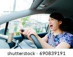 woman driving a car | Shutterstock . vector #690839191