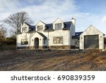 Small photo of Swansea, UK: January 02, 2015: An individually designed detached, luxury property near completion. Self build is possibly the most inexpensive way to attain a large detached home in the suburbs.