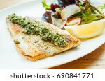 grilled sea bass fish meat... | Shutterstock . vector #690841771
