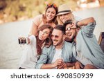 happy young friends having fun... | Shutterstock . vector #690850939