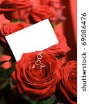 Valentine's day two hearts pendant and a ring on red rose with copy space. - stock photo