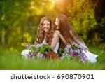 two happy girls. summer outdoor ... | Shutterstock . vector #690870901
