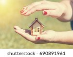 female hands holding and saving ... | Shutterstock . vector #690891961