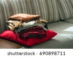 a stack of warm blankets on the ... | Shutterstock . vector #690898711