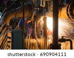 male  worker wearing protective ... | Shutterstock . vector #690904111