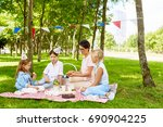 three girls and their mother... | Shutterstock . vector #690904225