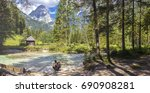 woman takes a rest at the river ... | Shutterstock . vector #690908281