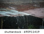 heavy rain on old zinc roof | Shutterstock . vector #690911419