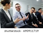 business experts discussing... | Shutterstock . vector #690911719