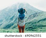 explorer young woman in a hat... | Shutterstock . vector #690962551