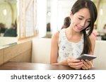 woman using smart phone   Shutterstock . vector #690971665