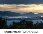 sunrise and layer of mountain... | Shutterstock . vector #690979861