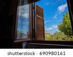 window with open wooden... | Shutterstock . vector #690980161