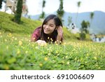 smiling teenage girl lying down ... | Shutterstock . vector #691006609