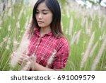 beautiful woman walking on... | Shutterstock . vector #691009579