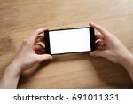 young man hands holding... | Shutterstock . vector #691011331