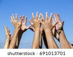 group raising hands against... | Shutterstock . vector #691013701
