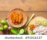 fish canned in tomato sauce...   Shutterstock . vector #691016137