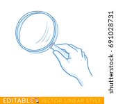 magnifying glass in a hand.... | Shutterstock .eps vector #691028731
