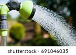 the girl takes a shower in the... | Shutterstock . vector #691046035