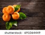 tangerines top view on a wooden ... | Shutterstock . vector #691064449