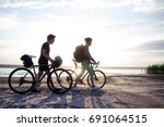 two tourists with bicycle... | Shutterstock . vector #691064515