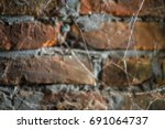burned brick wall with spider... | Shutterstock . vector #691064737