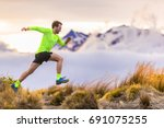 trail runner man running on new ... | Shutterstock . vector #691075255
