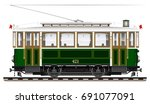 an old biaxial tram of green... | Shutterstock .eps vector #691077091