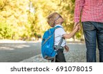 parent taking child to school.... | Shutterstock . vector #691078015