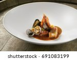 beautiful and tasty food on a... | Shutterstock . vector #691083199