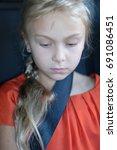 pensive face of a cute blond...   Shutterstock . vector #691086451