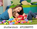 mother or nanny playing with a... | Shutterstock . vector #691088995