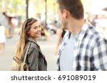strangers girl and guy flirting ... | Shutterstock . vector #691089019