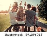 back view of happy young people ... | Shutterstock . vector #691096015