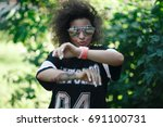 dancing stylish girl with tattoo | Shutterstock . vector #691100731