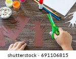 the child cuts out the details...   Shutterstock . vector #691106815