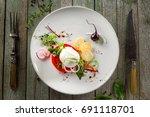 caprese salad made of fresh... | Shutterstock . vector #691118701