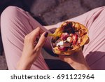 young woman eating bubble... | Shutterstock . vector #691122964