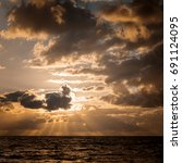 seascape. sun in the clouds at... | Shutterstock . vector #691124095