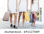 women legs with shopping bags ... | Shutterstock . vector #691127089