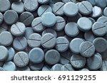 spirulina in pills   spirulina | Shutterstock . vector #691129255