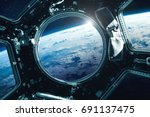 porthole of space station near... | Shutterstock . vector #691137475