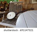 vintage banjo on old wooden...