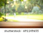 empty wooden on blurred nature... | Shutterstock . vector #691149655