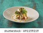 beautiful and tasty food on a... | Shutterstock . vector #691159219