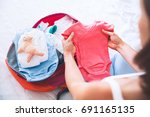 pregnant woman packing suitcase ... | Shutterstock . vector #691165135