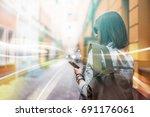 european female backpacker... | Shutterstock . vector #691176061