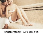 young couple relaxing inside... | Shutterstock . vector #691181545