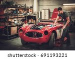 mechanic polishning car in... | Shutterstock . vector #691193221